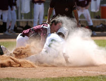 Collision At Homeplate High School Baseball Action. This was a High School game that was played in Arizona showing a play at the plate with a catcher and Stock Photo