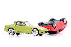 Collision of two car models. Two models of cars after a crash on a white background Royalty Free Stock Photos