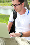 Colllege student working on assignments using laptop Royalty Free Stock Photo
