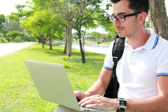 Colllege student working on assignments using laptop Royalty Free Stock Photography
