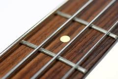 Collo di una chitarra bassa elettrica Fotografia Stock
