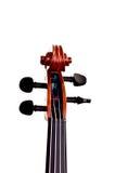 Collo e rotolo del violino su fondo bianco Immagini Stock