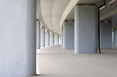 Collonade under the bridge. Highway Royalty Free Stock Images