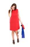 Colloquio della donna di acquisto sul telefono delle cellule Fotografia Stock Libera da Diritti