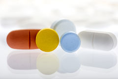 Collor pills on white background Stock Images