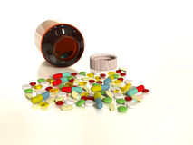 Collorful pills spilled from bottle Royalty Free Stock Images