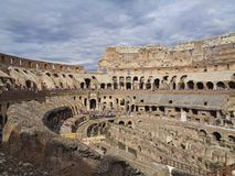 The colloseum in rome with cloudy sky. Above royalty free stock photos