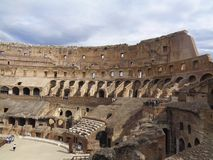 The colloseum in rome with cloudy sky. Above royalty free stock photography