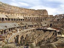 The colloseum in rome with cloudy sky. Above stock photos