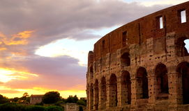Colloseum in Rome. During evening with purple, yellow and red skies Stock Images