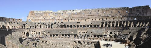 Colloseum in Rome. Rome, Italy-March 7, 2015; Panorama photo of the Colloseum with tourists. This is an UNESCO World Heritage site. March 7, 2015 Rome, Italy royalty free stock images