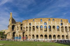 Colloseum in Rome, Italy. Unidentified people by Colloseum in Rome, Italy. It is most remarkable landmark of Rome and Italy. Colosseum is an elliptical stock photo