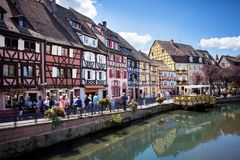 COLMAR, ALSACE – FRANCE. Colorful traditional french houses on the side of river Lauch in Petite Venise, Colmar, France. Colmar, Alsace, France. Petite Stock Images
