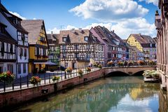 COLMAR, ALSACE – FRANCE. Colorful traditional french houses on the side of river Lauch in Petite Venise, Colmar, France. Colmar, Alsace, France. Petite Stock Image