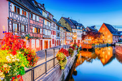 Colmar, Alsace, France. Little Venice, water canal and traditional half timbered houses stock photo