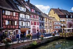 COLMAR, ALSACE – FRANCE. Colorful traditional french houses on the side of river Lauch in Petite Venise, Colmar, France. Colmar, Alsace, France. Petite Royalty Free Stock Images
