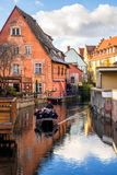 Colmar in Christmas. Photograph of channel with a boat full of visitors of Colmar in the winter time, Colmar, France Stock Photography