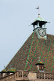 Colmar clock, , France. Clock in a historic building of Colmar in French Alsace Stock Image