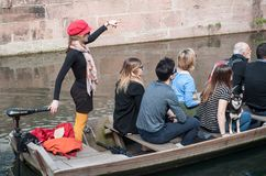 Boat trip tourism on water at little Venice. COLMAR - France - 6 April 2018- Boat trip tourism on water at little Venice stock photos