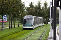 Modern eco-friendly electric public transport in city in evening. Colmar, France - September 19, 2017: modern eco-friendly electric public transport in city Royalty Free Stock Photos