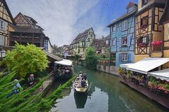 Wedding photography on a small boat cruising through Lauch River at Little Venice of Colmar, France