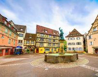 Colmar, Petit Venice, fountain, square and traditional houses. Alsace, France. Stock Image