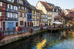 COLMAR SEPTEMBER 19, 2013: Colorful buildings in front of a river Royalty Free Stock Photos