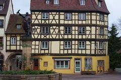 A statue in front of an old building at Colmar France stock photo