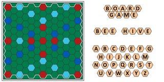 Colmena de la abeja del juego de mesa, erudición que se convierte, tablero del panal de la abeja y letras Fotografía de archivo