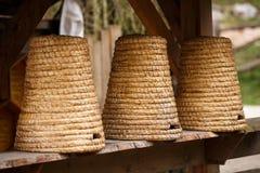 Colmenas viejas de la paja Imagen de archivo libre de regalías