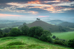 Colmer's Hill in Dorset. A stormy sunrise over Colmer's Hill at Symondsbury near Bridport in Dorset royalty free stock image