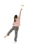 Colmo de pintura de la muchacha con el rodillo Imágenes de archivo libres de regalías