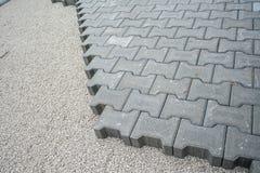 Colocação de telhas do pavimento pavimentar fotografia de stock
