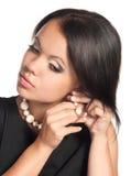 Colocação sobre earings imagens de stock
