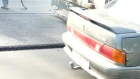 Colocación del nuevo asfalto metrajes