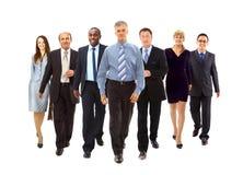 Colocación joven feliz de los hombres de negocios Imagen de archivo libre de regalías