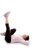 Colocação exercitando a mulher no fundo branco Imagens de Stock Royalty Free
