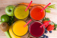 Colofrul fresh pressed fruit juices in tall glasses with fruits Stock Image