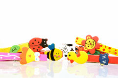 Coloful cartoon wooden clothes pin. Many coloful cartoon wooden clothes pin Stock Images
