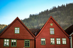 Coloful houses and facades of bryggen in bergen. Houses and facades of bryggen in bergen with wood in the background, norway Royalty Free Stock Image