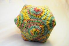 Coloful knitted wool yarn polygon soft-toy. Detail of a knitted colorful yarn polygon Stock Image