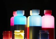 Coloful liquid. Colorful liquid in plastic opaque bottles Stock Images