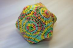 Coloful polygon knitted textile toy. YARN Stock Image