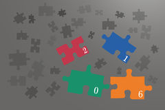 Coloful puzzle pieces on the grey background. Happy new year card of puzzle pieces. Colorful pieces with the numbers 2016 are falling. All is on the  grey Royalty Free Stock Photo