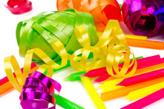 Coloful ribbons and cake candles  on white Royalty Free Stock Photo