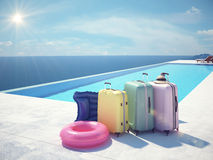 Coloful suitcases next to the swimming pool. 3d rendering Stock Photos