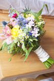 Coloful Wildflower Bouquet. On a wooden board royalty free stock image