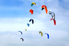Colofull kites high in bright blue sky Stock Image