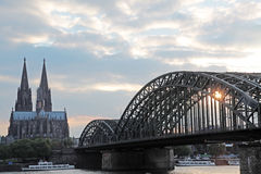Cologne. Cathedral and Hohenzollernbruecke bridge at dusk Royalty Free Stock Image