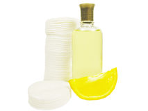Cologne bottle with cotton pads. Isolated royalty free stock photos